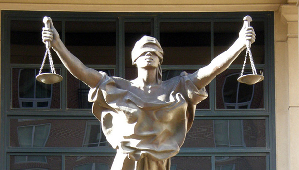 Justice on the ALbert V Bryan Courthouse in Alexandria VA sends mixed messages.
