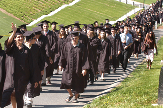 Amherst, 5/28/06, Staff Photo by David Molnar -- A long line of Amherst College graduates wind through the campus on their way to Commencement exercises.CUTLINE: 5/29/06 -  A long line of Amherst College graduates makes its way toward commencement ceremonies at the school yesterday. The college's 185th commencement ceremony graduated 430 students.